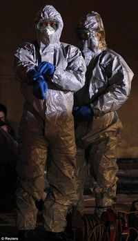 Japanese Workers Dressing to Avoid Radiation Damage - from Reuters